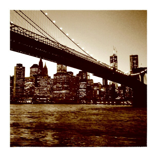 City Lights#cityscape #city #bridge #lights #skyscrapers #river #ropes #dusk #nyc #newyork #ny #brooklyn #brooklynbridge #instatweet #instalife #instamood #tweegram #landscape #picoftheday #bestoftheday #ratemygram #followforfollow #likeforlike #sepia #instamood #instagood #manhattan - from Instagram