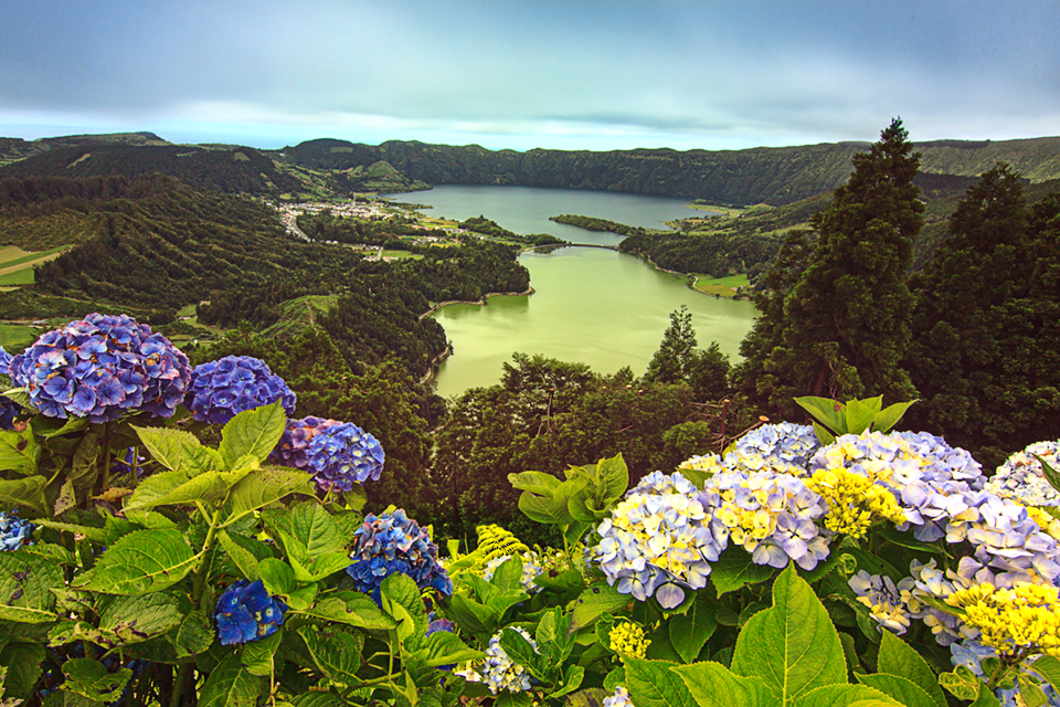 Two lakes, green and blue, in Lagoa das Sete Cidades crater dormant volcano